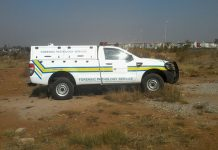 Forensic pathological services van with dead body inside