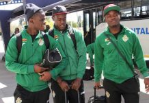 MEN OF THE MOMENT . . . Warriors players (from left) Donovan Bernard, Blessing Moyo and Tatenda Mukuruva chat at Harare International Airport before their departure for Namibia for the Cosafa tournament yesterday