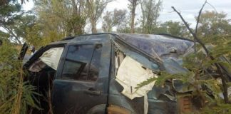 A Zimbabwean government minister survived a near-fatal crash when one of the wheels of his car came off, causing the vehicle to roll