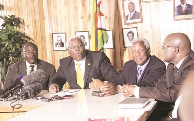 Home Affairs Minister Dr Ignatius Chombo addresses the media while flanked by State Security Minister Kembo Mohadi (left), Defence Minister Dr Sydney Sekeramayi (third from left) and Information, Media and Broadcasting Services Minister Dr Chris Mushohwe in Harare. — (Picture by Munyaradzi Chamalimba)