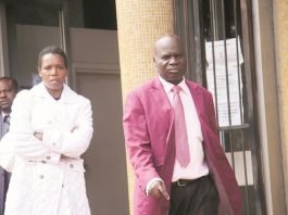 Former MDC-T legislator Timothy Mubhawu (right) leaves the court with wife Molleen after the withdrawal of his domestic violence case. (Picture by Munyaradzi Chamalimba)
