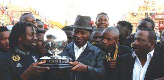 NA Commander Lieutenant General Phillip Valerio Sibanda presents the ZNA Charity Trophy to Highlanders Captain Felix Chindungwe while ZIFA Vice President Omega Sibanda looks on at Barboufields Stadium in Bulawayo yesterday.