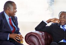 File picture of Gideon Gono seen here with with President Robert Mugabe