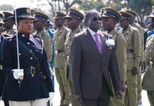President Robert Mugabe inspecting a police pass out parade