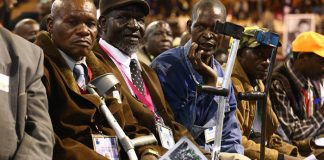 Photo: Some of the former Zimbabwe liberation war fighters who were injured during the Liberation war attend a meeting with their patron and President Robert Mugabe at the City Sports Centre in Harare, Zimbabwe, 7 April 2016. Zimbabwe has about 34,000 living war veterans and it is the first time ever that Mugabe has held a meeting of this nature which was meant to discuss corruption and the welfare of the war veterans. EPA/AARON UFUMELI