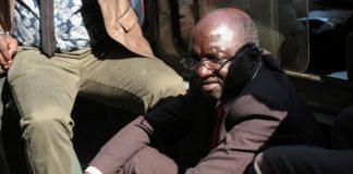War veterans' spokesperson Douglas Mahiya in handcuffs