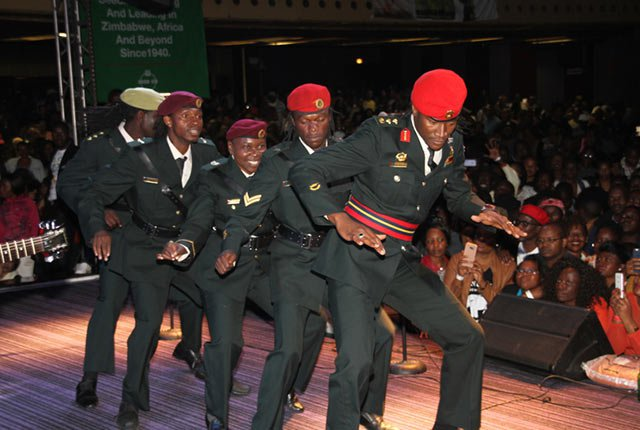 "MAIN ACT . . . Jah Prayzah leads his troops in a dance drill at ""Mdhara Vachauya"" album launch at the Harare International Conference Centre on Friday night"