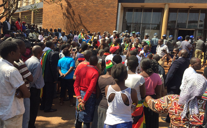 Supporters wait outside the Magistrates Court in Harare on Monday