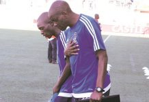 IN GOD WE TRUST . . . Dynamos head coach Lloyd Mutasa (right) and his assistant Murape Murape pray before yesterday's kick-off of their side's Castle Lager Premiership soccer match against Bulawayo City at Rufaro. — (Picture by Tawanda Mudimu)