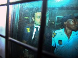 Prison sources claimed Oscar Pistorius, pictured, cried himself to sleep on the first night