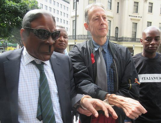 President Mugabe was symbolically put on trial at the Zimbabwe Vigil in London and ordered to leave office for crimes against the people and economy of Zimbabwe. He had earlier been arrested by human rights activist Peter Tatchell, who had unsuccessfully tried to make a citizen's arrest of Mugabe in London in 1999 and Brussels in 2001.