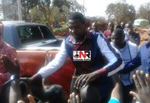 Prophet Walter Magaya greets his supporters outside the Harare Magistrates Court