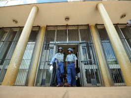 Zimbabwean riot police patrol outside Harare Magistrates Court