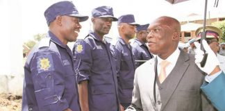 Police Commissioner-General Augustine Chihuri (right) greets Superintendent Augustine Zimbili during a parade for Sudan-bound ZRP officers on UN peacekeeping duties