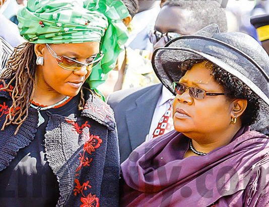 In happier times: First Lady Grace Mugabe and the then Vice President Joice Mujuru