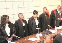 Chief Magistrate Mr Mishrod Guvamombe (right) swears in magistrates (from left) Rumbidzai Dzumbira, Edith Kakuruwo, Nyasha Marufu and Joshua Mawere at the Harare Magistrates' Court on Friday. — Picture by Munyaradzi Chamalimba