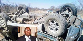 Minister Mathema (inset) and his car on its roof after the accident.