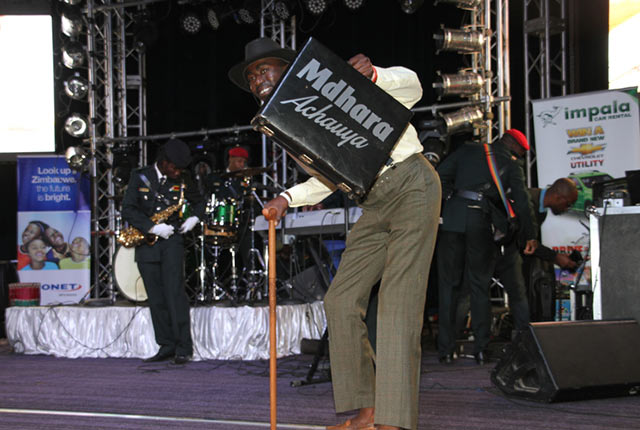 FANFARE . . . A fan joins Jah Prayzah's band on stage holding a 'Mdhara Achauya' briefcase