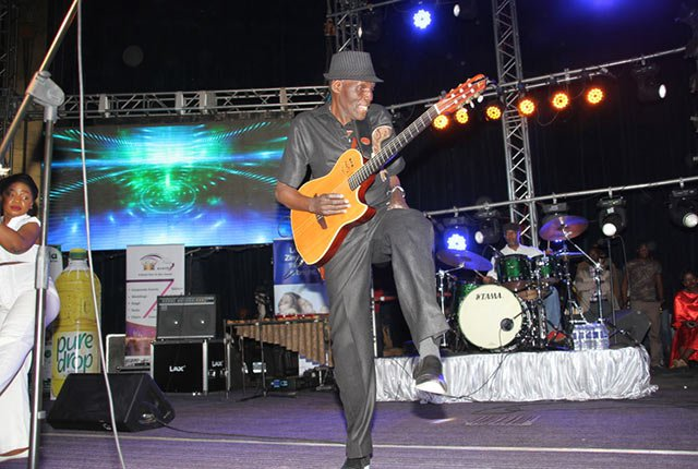 "superstar glitz. . . Oliver Mtukudzi performs at ""Mdhara Vachauya"" album launch"