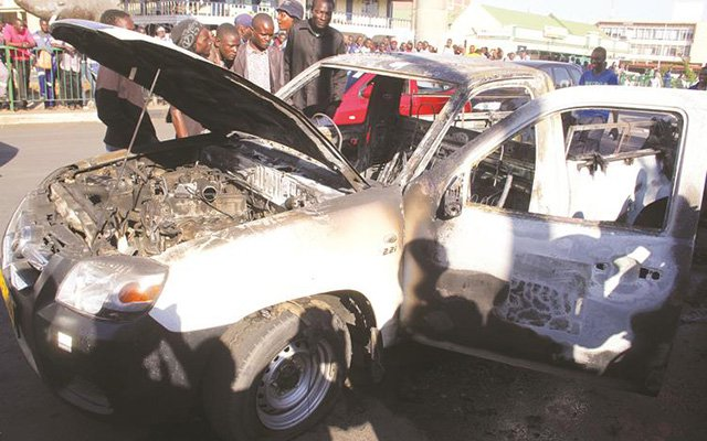 police car set on fire during mdc demo 2
