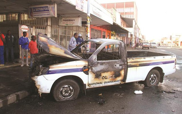 police car set on fire - mdc demo
