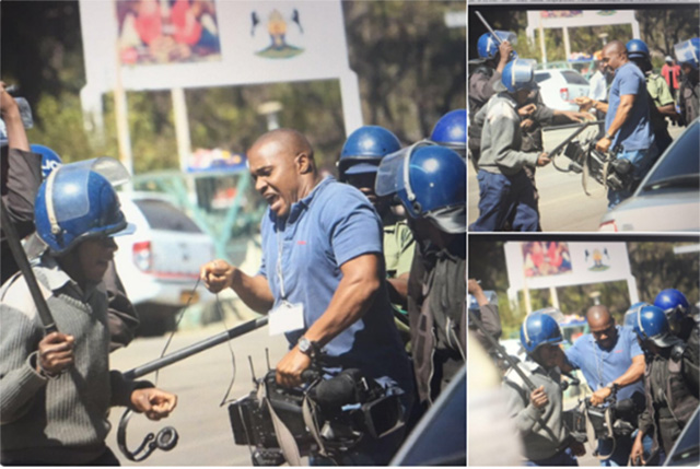 Riot police assaulting a journalist and smashing his camera during the demonstrations on Wednesday (Picture by Journalist Nomsa Maseko via Twitter)