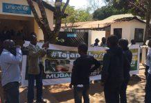 Members of Tajamuka-Sesijikile Campaign demonstrating outside the Unicef offices in Harare. (Photo: Patricia Mudadigwa)