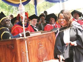 President Mugabe shares a lighter moment with the youngest University of Zimbabwe graduate Maud Chifamba who graduated with a Bachelor of Accountancy Honours degree in Harare yesterday. — (Picture by John Manzongo)