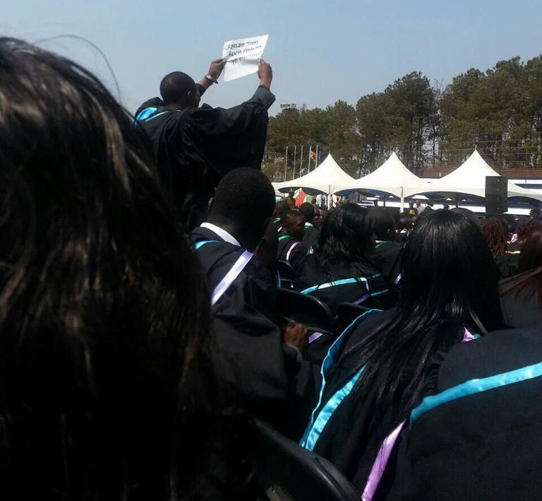 $10 fine for student who waved placard at Mugabe