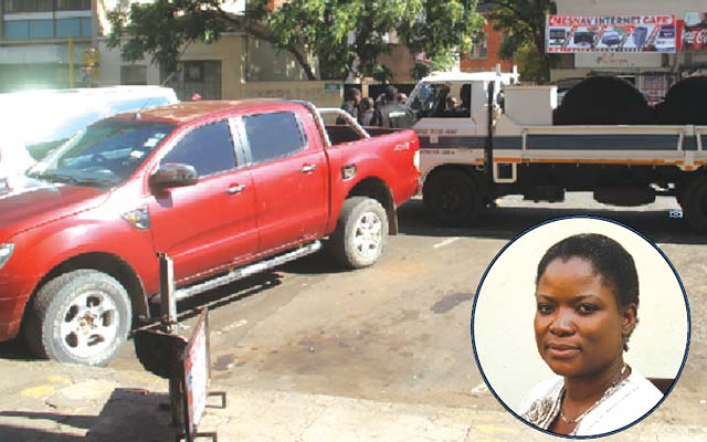 Staff from the Messenger of Court attach Cde Kagonye's (INSET)double cab Ford Ranger along George Silundika in Harare
