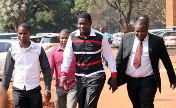 PHD Ministries Prophet Walter Magaya (centre) arrives at Harare magistrate courts while escorted by his lawyer Everson Chatambudza(right) and overseer Admire Mango yesterday.(Picture by Innocent Makawa)