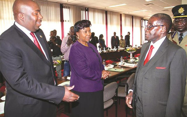 President Mugabe talks to Local Government, Public Works and National Housing Minister Saviour Kasukuwere while Environment, water and Climate Minister Oppah Muchinguri-Kashiri looks on during a Politburo meeting in Harare yesterday. — (Picture by John Manzongo)