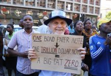 A man protests over the state of the economyWilfred Kajese/ AFP