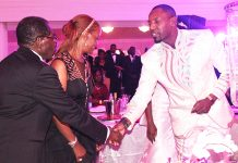 Simba Chikore seen here with President MUgabe and wife Grace