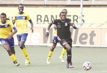 Tsholotsho FC player Simbarashe Gorododyo (right) in a match against Harare City