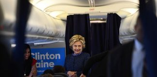 Hillary Clinton talks to staff onboard her campaign plane in White Plains, New York Friday. Photograph: Jewel Samad/AFP/Getty Images