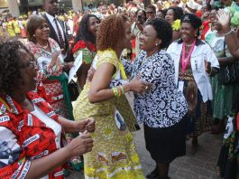 First Lady Grace Mugabe (left) greets Deputy Secretary for Environment and Tourism Auxillia Mnangagwa at the Women's League National Assembly meeting in Harare. — Picture by Justin Mutenda