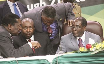 President Mugabe speaks to Vice President Emmerson Mnangagwa while Vice President Phelekezela Mphoko and Secretary for Commissariat Saviour Kasukuwere looks on at the Women's league National Assembly meeting in Harare yesterday. Picture by Justin Mutenda