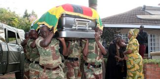 Pall-bearers carry a casket bearing the body of national hero Cde Cephas George Msipa in Borrowdale, Harare, yesterday. The former Midlands Governor and zanu-pf Politburo member will be buried at the National Heroes Acre today. —(Picture by Tawanda Mudimu)
