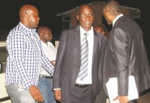 Higher and Tertiary Education, Science and Technology Development Minister Professor Jonathan Moyo speaks to his lawyer Mr Terrence Hussein (right) and son-in-law Tafadzwa Wakatama (left) at the Zimbabwe Anti-Corruption Commission offices in Mt Pleasant, Harare, yesterday evening