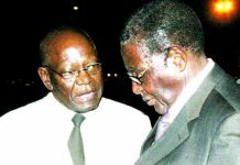 Mutasa seen here with President Mugabe in happier times
