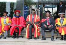 Jonathan Moyo (second left) and President Robert Mugabe (centre) at the NUST graduation ceremony in Bulawayo