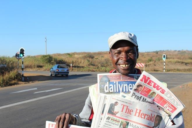 A newspaper vendor in Zimbabwe