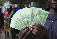 "Zimbabwe launches ""bond notes"" currency in bid to ease cash crunch"