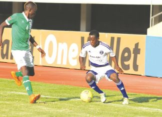 HOT PROPERTY . . . Highly-rated midfielder Brett Amidu (right) works his way past CAPS United defensive pillar Dennis Dauda during the reverse fixture of the Harare Derby at the National Sports Stadium where he provided two assists for the Glamour Boys' three goals in the six-goal thriller. — (Picture by Kuda Hunda)