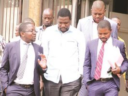 PHD Ministries leader Prophet Walter Magaya (centre) flanked by lawyers Advocate Thabani Mpofu (left) and Admire Rubaya as he made his way out of the Harare Magistrates' Courts recently. He is expected back at the same court on December 19. (Picture by Innocent Makawa)
