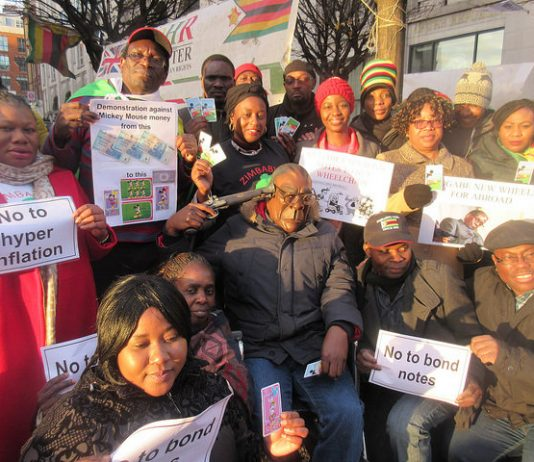 Activists from the Zimbabwe Vigil protest in London