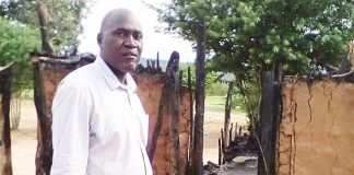 Chief Siachilaba shows the hut that was struck by lightning at his homestead in Binga