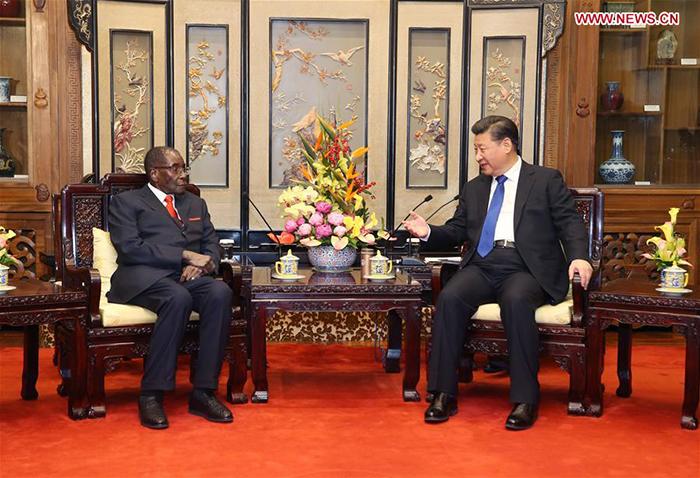 Chinese President Xi Jinping (R) meets with his Zimbabwean counterpart, Robert Gabriel Mugabe, in Beijing, capital of China, Jan. 9, 2017. (Xinhua/Yao Dawei)