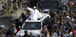 Gambian president Adama Barrow greets the crowds at Banjul airport. Photograph: Jerome Delay/AP